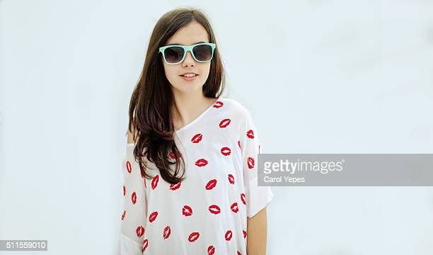 teenager  with sunglasses.studio shot - thick rimmed spectacles - fotografias e filmes do acervo