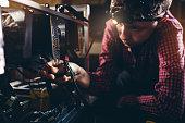 teenager working gpu mining rig to
