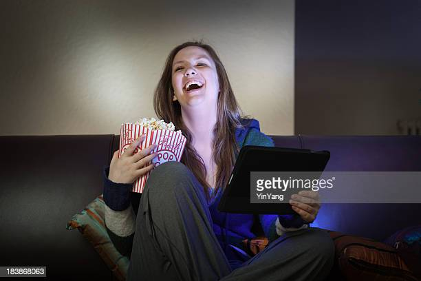 Teenager Youth Watching Movie and Streaming Video with Tablet Computer