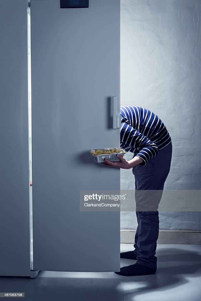 TeenagerCaught Getting a Midnight Snack From The Fridge : Stock Photo