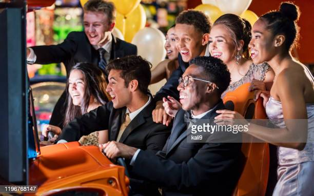 teenagers after prom at video arcade - prom dress stock pictures, royalty-free photos & images