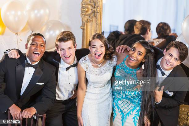 teenagers and young adults in formalwear at party - prom stock pictures, royalty-free photos & images