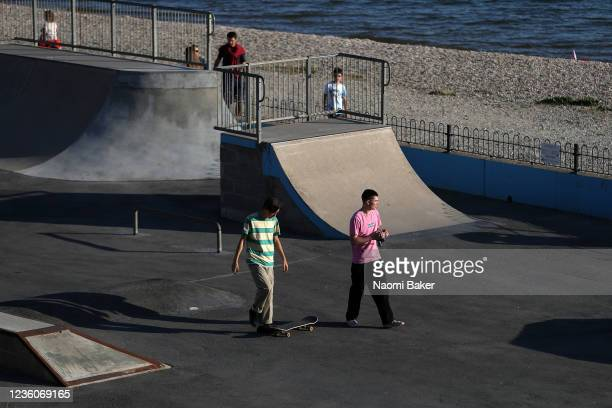 Teenagers are seen skate boarding inside a closed playground park by the beach on May 30 2020 in LeeOnTheSolent England The British government...