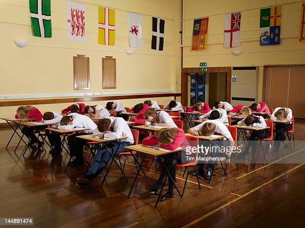 Teenagers asleep in school Hall