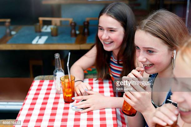 Teenagers at a cafe table