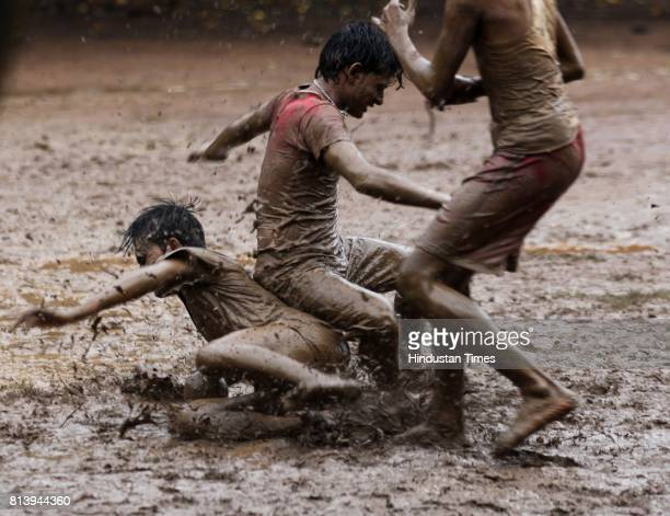Teenagers at Five gardens enjoying a game of football that is a favourite in monsoons