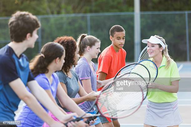 teenagers at tennis clinic - sports team event stock photos and pictures