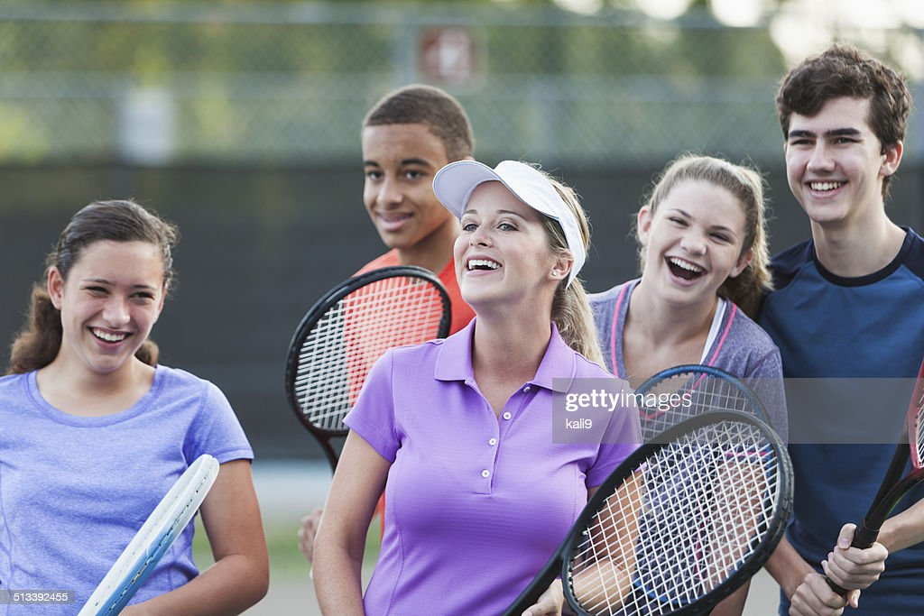 Teenagers at tennis clinic : Stock Photo
