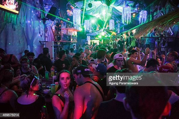 Teenagers attend a party in a night club during Australian 'schoolies' celebrations on November 26 2014 in Kuta Bali Indonesia This year around 6000...