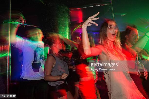 Teenagers attend a party in a nightclub during Australian 'schoolies' celebrations following the end of the year 12 exams on November 24 2013 in Kuta...