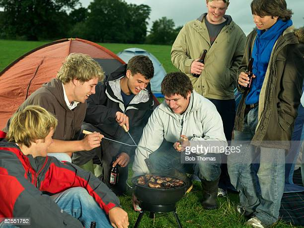 teenagers camping - snag tree stock pictures, royalty-free photos & images