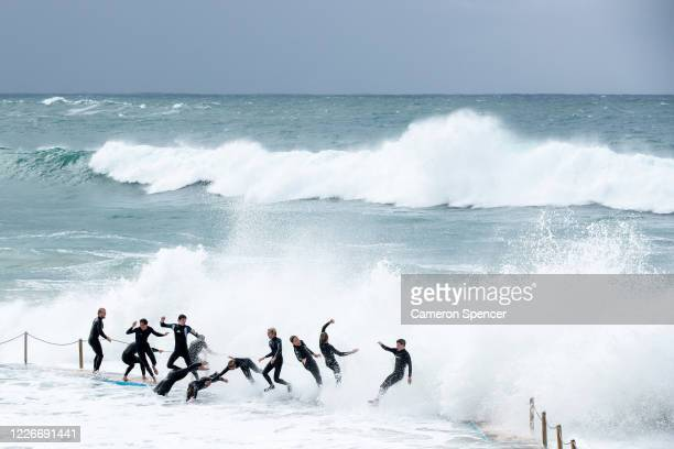 Teenagers chainsurf at South Curl Curl ocean pool as a large southerly swell hits the Sydney coastline on May 24 2020 in Sydney Australia Winter...