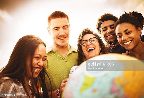 teenagers college student smiling with globe - ethnicity stock pictures, royalty-free photos & images
