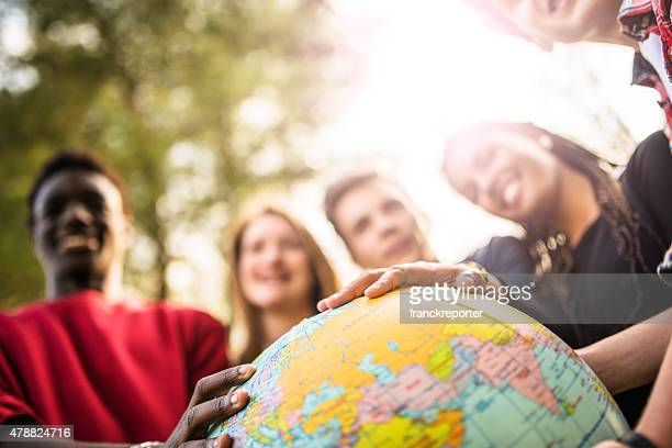 teenagers college student smiling with globe