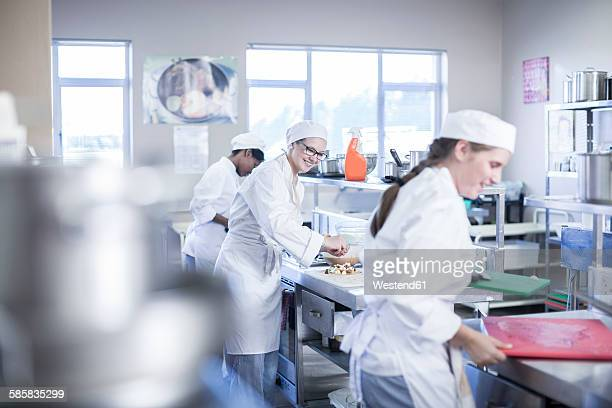teenagers cooking in canteen kitchen - teenagers only stock pictures, royalty-free photos & images
