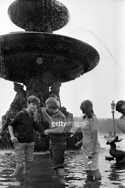 Teenagers cool off in the Fontaines de la Concorde during a heat period on august 1970 in Paris