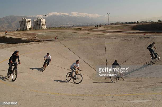 Teenagers cycle on a track in Chitgar park, situated on the western outskirts of Tehran, Iran, 24th March 2004. Cycling in public places was...