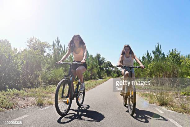 teenagers cycling on countryside road, aquitaine, france - teenagers only stock pictures, royalty-free photos & images