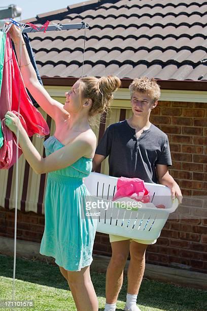 Teenagers Doing Washing