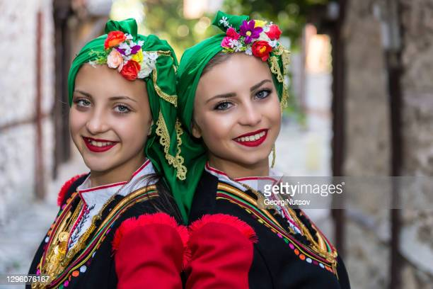 teenagers dressed in bulgarian folk costumes - folk music stock pictures, royalty-free photos & images