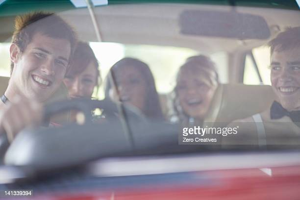 Teenagers driving in formal wear