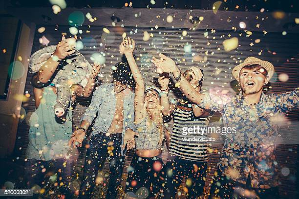 Teenagers Enjoying Confetti Whilst Partying In Street