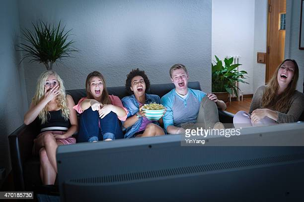 teenagers friends watching funny tv streaming broadcast movie show - television show stockfoto's en -beelden