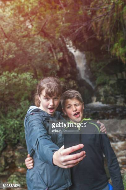 Teenagers Funny Selfie at a waterfall