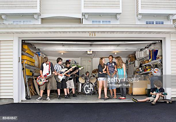 teenagers garage band practicing