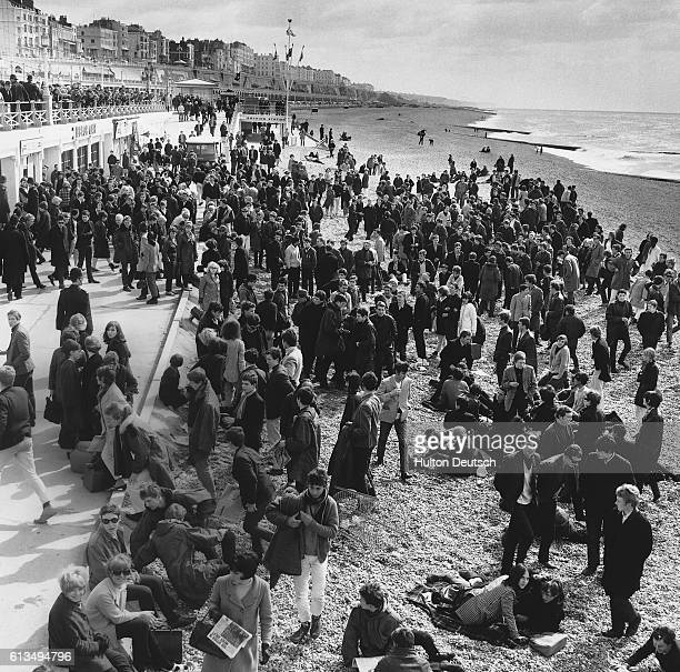 Teenagers gathering on the beach at Brighton in 1965