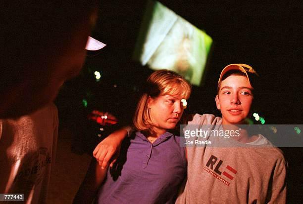 Teenagers hang out to socialize and watch the movies at the Fiesta drivein theater in Carlsbad New Mexico August 10 2000 The death of the drivein has...