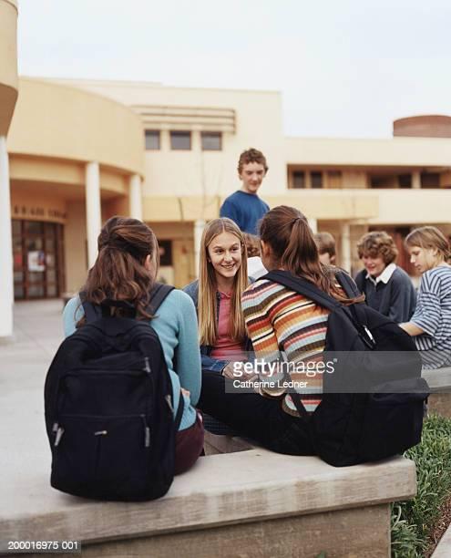 Teenagers (14-16) hanging around school during recess
