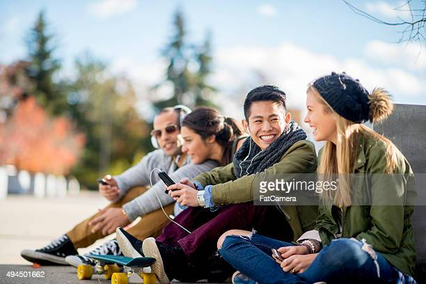 teenagers hanging out in the city - puberty stock photos and pictures