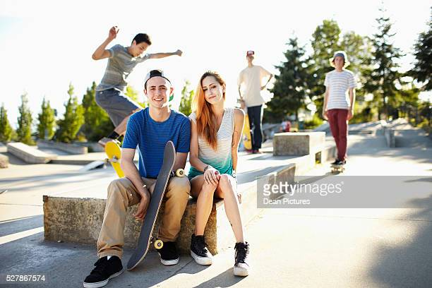 Teenagers (16-17) hanging out skateboarding