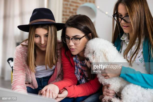 Teenagers hanging out together with their puppy