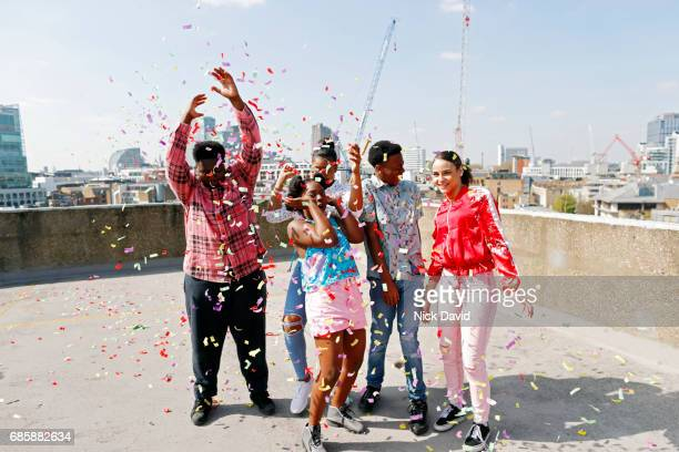teenagers having a rooftop party celebration. - confetti stock pictures, royalty-free photos & images