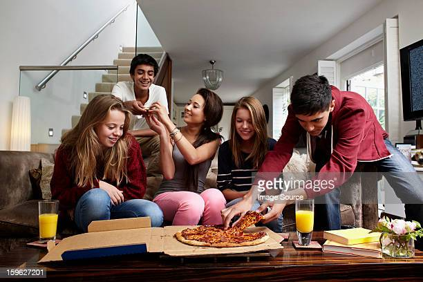 Teenagers having take away pizza
