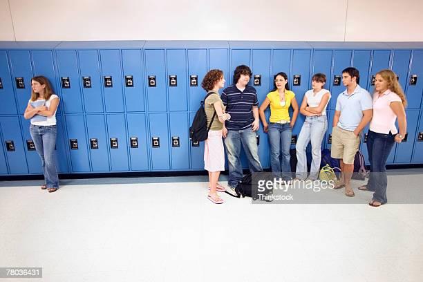 Teenagers ignoring girl