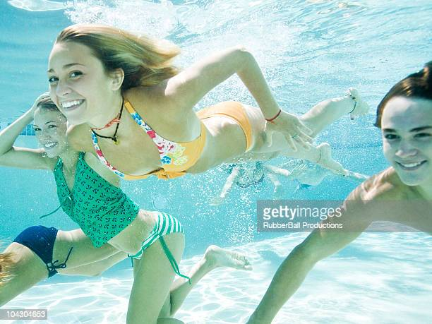 teenagers in a swimming pool - orem utah stock pictures, royalty-free photos & images