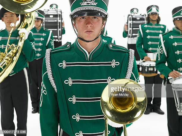 Teenagers (15-17) in band uniforms (focus on boy in foreground)
