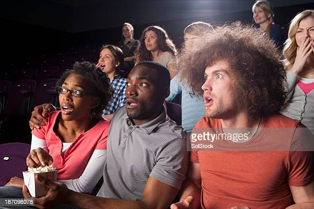 teenagers in cinema - scary movie stock photos and pictures