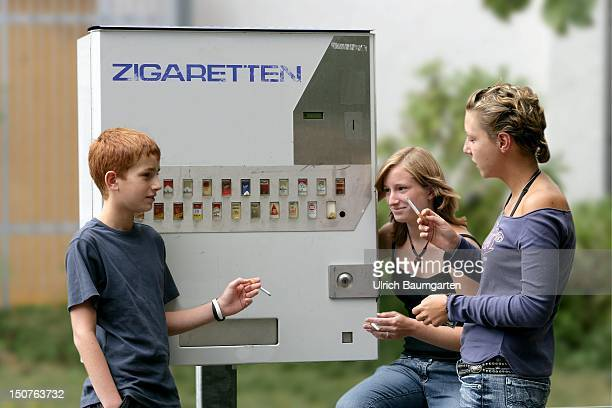 Teenagers in front of a cigarette automat