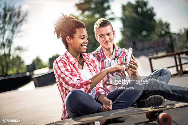 Teenagers in skate park in Europe