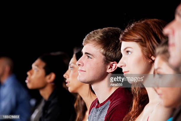 teenagers in the movie theater - divergent film stock photos and pictures