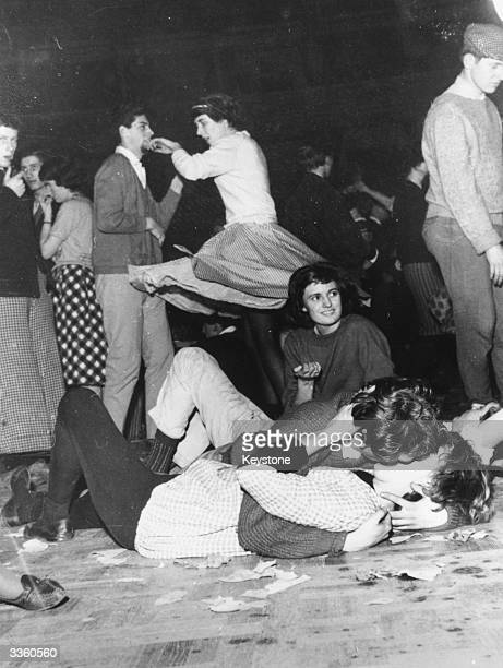 Teenagers kiss and dance the night away at the third all night 'Carnival of Jazz' at London's Royal Albert Hall.