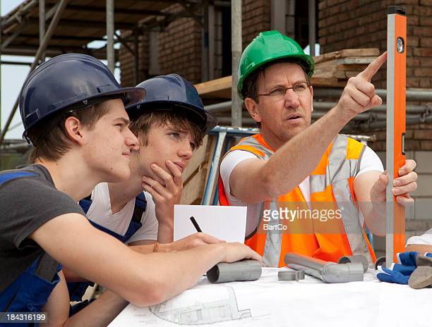 Teenagers learning a occupation. Trainee pipefitter.