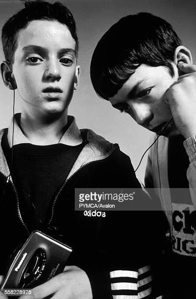 Teenagers listening to a Panasonic cassette walkman 1990s