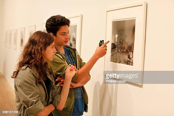 Teenagers looking at a picture at the Tate Modern