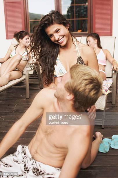 Teenagers on deck in swimwear