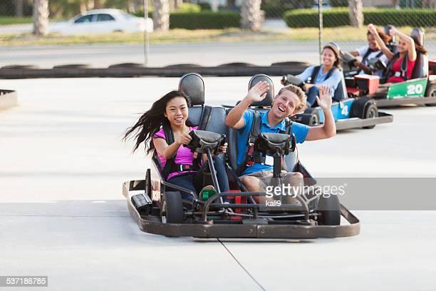 Teenagers on go carts